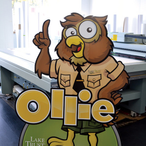 Ollie the Owl mascot standee printed on fluted PVC (Coroplast) complete with a collapsable stand.