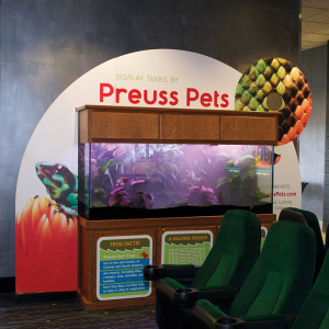 Preuss Pets' custom advertising display at NCG Cinemas Lansing location, designed by Traction, printed and installed by Capital Imaging on 6mm white PVC.