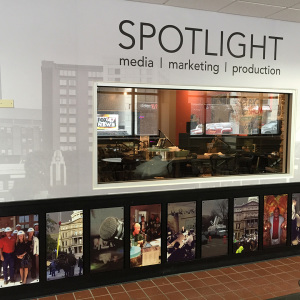 SPOTLIGHT's custom wallcovering and photo panels designed and printed by Capital Imaging.